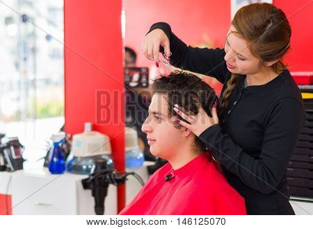 Hair between fingers is the technique used on a barber shops, scissors to cut the hair.