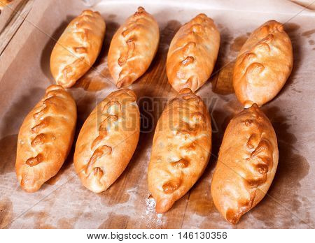 Delicious Fresh Pies And Buns With Meat And Vegetables On Shelf In Bakery Shop. Pastries And Bread I