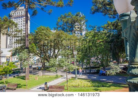 CURITIBA , BRAZIL - MAY 12, 2016: some people relaxing at a park in the downtown of the city.
