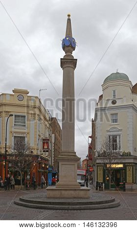 LONDON UNITED KINGDOM - JANUARY 28: Seven Dials Sundial in London on JANUARY 28 2013. Seven Dials Road Junction Roundabout at West End in London United Kingdom.