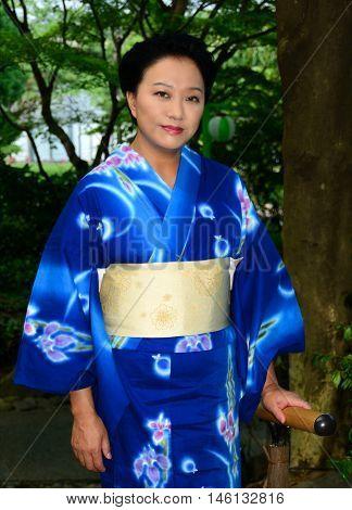 Beautiful Japanese woman wearing a blue Yukata