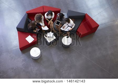 Overhead Shot Of Businesswomen Meeting In Lobby Of Office