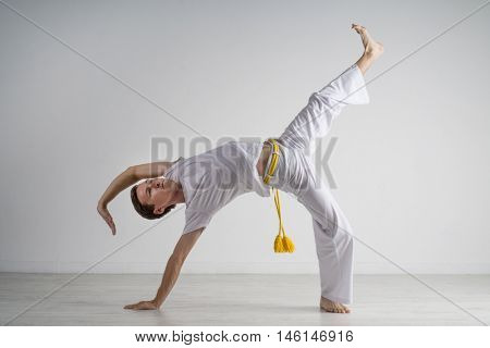 Man practicing capoeira , brazilian martial art.