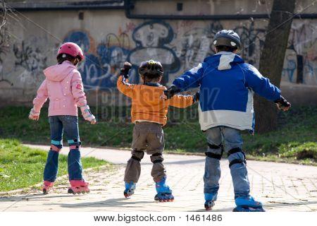Three Children Roller Blading