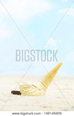 Fallen ice cream in sand
