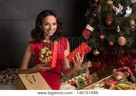 Woman open a gift box.Christmas season.Xmas tree