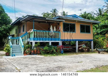 Labuan,Malaysia-Sept 8,2016:Labuan traditional house with fisherman boat in Malay traditional Batu Manikar village at Labuan,Malaysia.Batu Manikar village near with Manikar Beach Resort hotel,Labuan