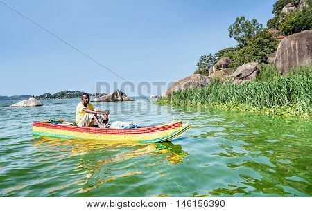 Mwanza,Tanzania,Africa- March 26. 2016: African Man transporting goods on the boat on lake Victoria in Mwanza Tanzania