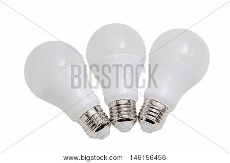 Three domestic light emitting diode lamp with a sized E27 male screw base on a light background