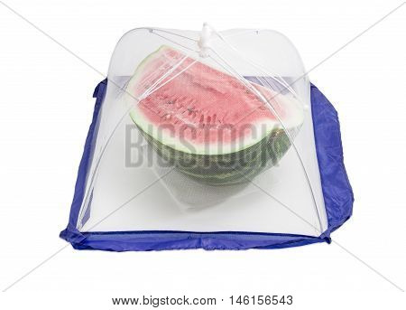 Part of watermelon under of a small special tent made of mosquito nets to protect the products against insects on a light background