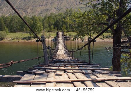 Bridge through Chulyshman river in the Altay mountains.