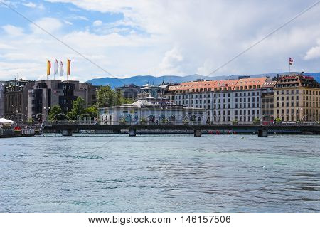 Geneva Switzerland - June 17 2016: Lake Geneva Embankment bridge. The Lake Geneva is a lake on the north side of the Alps shared between Switzerland and France.