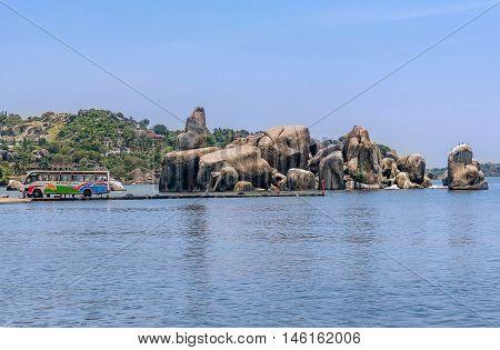 Mwanza,Tanzania,Africa- March 27, 2016: Bus and the rocks on the shore of Lake Victoria Tanzania