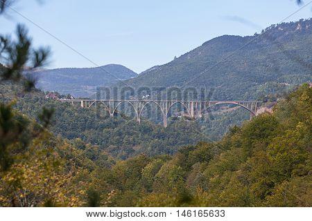 Durdevica arched Tara Bridge over green Tara Canyon - Montenegro.