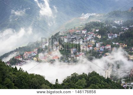 Sapa valley city in the mist in the evening, Vietnam poster