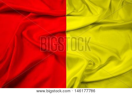 Waving Flag of Grenoble France, with beautiful satin background. 3D illustration