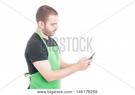 Hypermarket Seller Texting On Smartphone