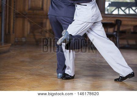 Tango Dancers Performing Gancho Step In Restaurant