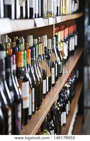 Wine Bottles Displayed On Shelves