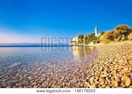 Monastery on pebble beach in Bol island of Brac Dalmatia Croatia