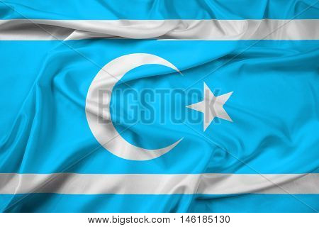 Waving Flag of Iraqi Turkmen Front, with beautiful satin background. 3D illustration