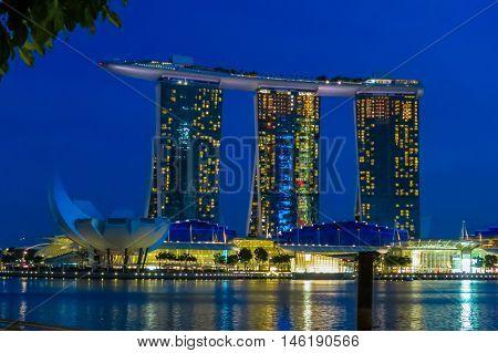 SINGAPORE, REPUBLIC OF SINGAPORE - JANUARY 08, 2014: View of Marina bay and Marina Bay Sands Resort Hotel by night, Singapore
