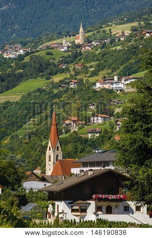 View of Saint Andreas Catholic church in the center of Chiusa Northern Italy