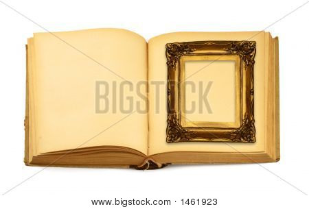 Decorative Frame Lying On An Open Book