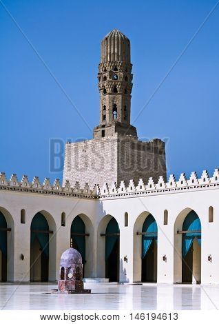 Cairo Egypt - September 28 2012: Minaret of Al Hakem Mosque (The Enlightened Mosque) located in Muizz Street south of Bab Al-Futuh (one of the doors of old Cairo city)