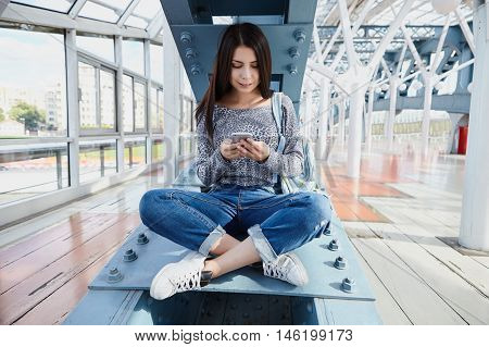 Brunette Young Girl Using Big Silver Modern Smart Phone