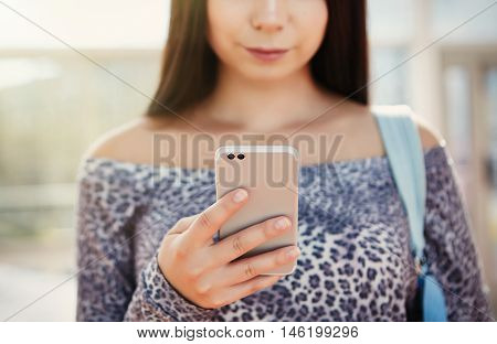 Young Pretty Model Using Modern Dual Camera Smart Phone