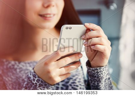 Cute White Girl Using Modern Dual Camera Smart Phone