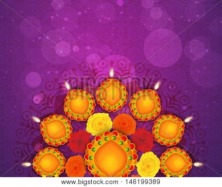 Traditional illuminated oil lit lamps with colorful flowers for Indian festival of lights, Happy Diwali concept.