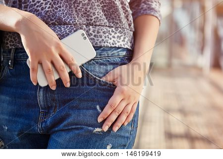 Girl Holding Modern Dual Camera Smart Phone In Hand