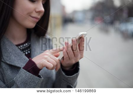 Young Brunette Girl Using Modern Smart Phone