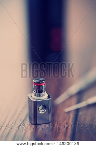 Upgrade parts for modern vaporizer boxmod e-cig device spare part with kanthal clapton coil drip. Modern device model and microcoil clearomizer. Good way to quit smoking nicotine cigarette and improve health. Macro close up poster