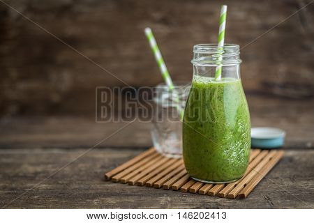 Healthy Fresh Green Smoothie on Rustic Wood