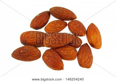 Roasted salted Almond nuts with salt isolated on white background.