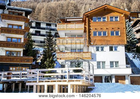 Modern wooden hotels with a wooden terrace in the charming Swiss resort of Saas-Fee, Switzerland