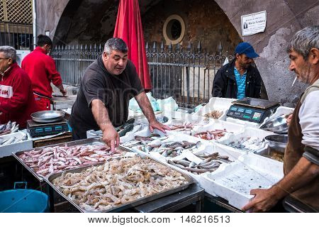 Catania Italy - October 23 2015: Fisherman selling swordfish to the fish market in Catania Sicily Italy. Today is one of the tourist attractions of the city