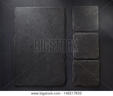 slate stone at wooden background texture