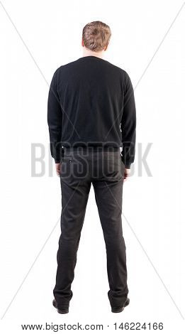 back view of Business man  looks ahead. Young guy in sweater watching.  Rear view people collection.  backside view of person.  Isolated over white background. office worker with his hands down looks