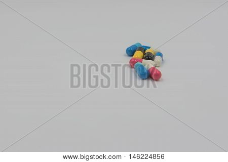 Colorful capsule drug on white , background