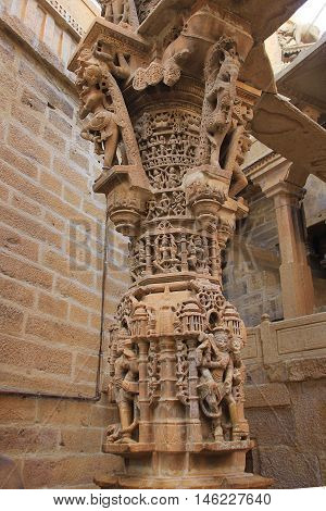 Intricately carved red marble pillar at Jain Temple in Jaisalmer Fort Jaisalmer Rajasthan India Asia