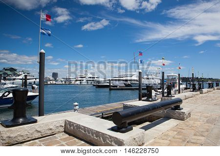 Boston,Massachussetts,USA - July 2,2016:Tourist ships and yachts in harbor. Boston tourism annually brings about 8 billion dollars