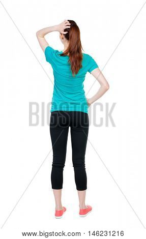 Back view of shocked woman. upset young girl. Rear view people collection.  backside view of person.  Isolated over white background. Sports girl thoughtfully scratching his head.