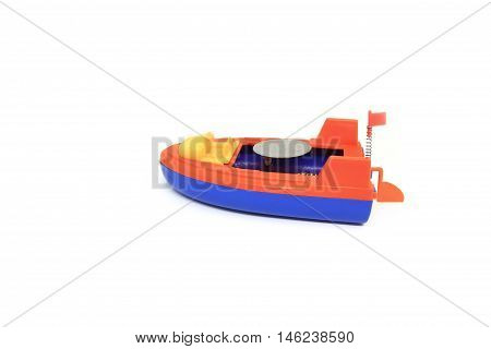 Little plastic toy ship on the white background