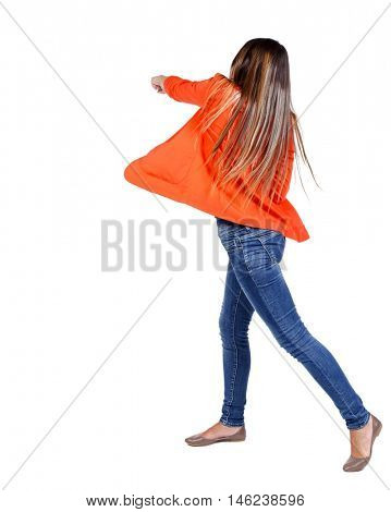 back view of woman funny fights waving his arms and legs. student in red jacket hand strikes.