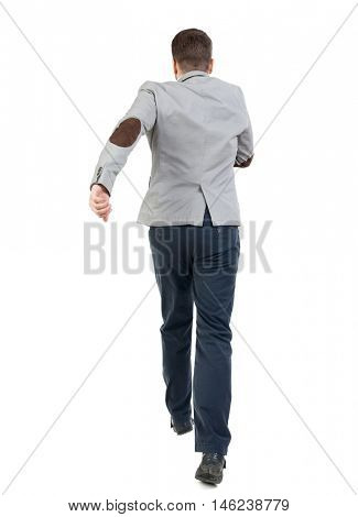 Back view of running business man. Walking guy in motion. bearded man in a gray jacket jump.
