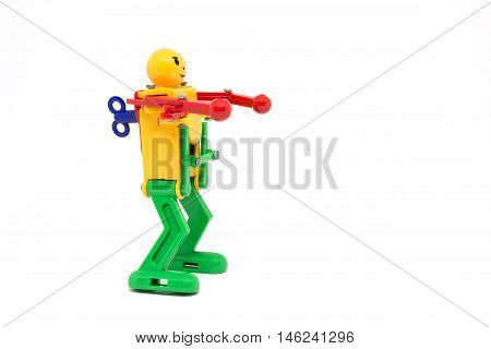 closeup robot toy winder on white background